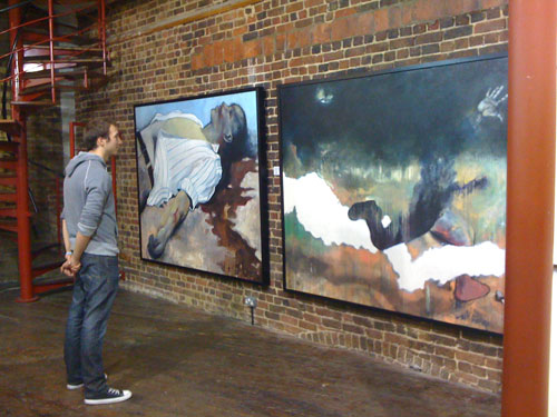 Ben Lovecek viewing artworks at the London Exhibition